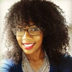 Glasses Curly Hair Headshot of Tiffany