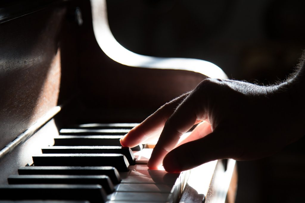 Hand Playing Piano Musical Keyboard