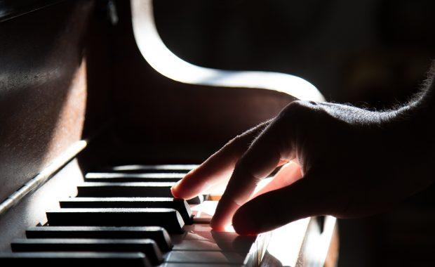 Hand Playing Piano Musical Keyboard
