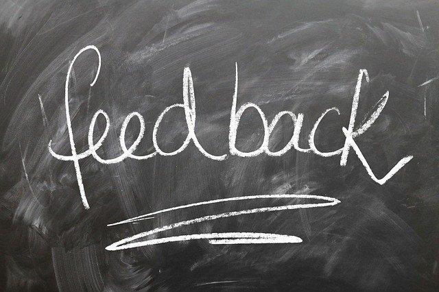 feedback written on a black board w/ chalk